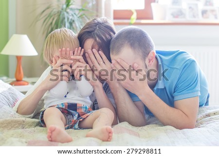 Young Attractive Parents and Child Portrait indoor - stock photo