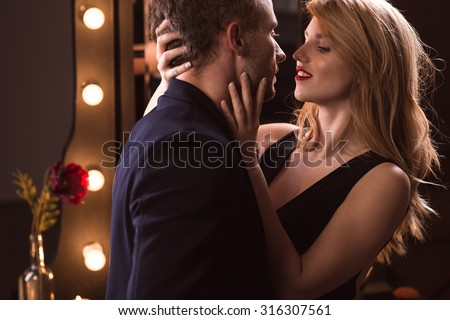 Young attractive passionate couple wearing elegant clothes - stock photo