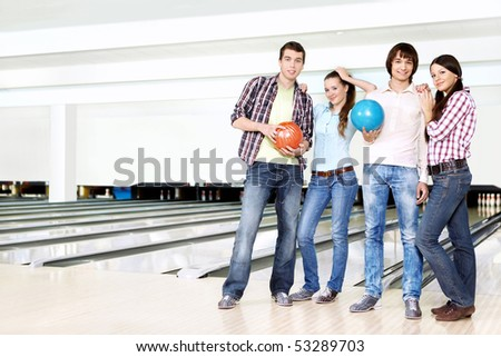 Young attractive people hold spheres for bowling - stock photo