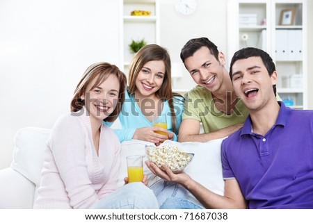 Young attractive people in the apartment - stock photo