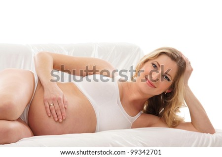Young attractive pregnant woman isolated on white - stock photo