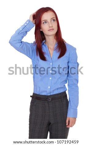 Young attractive redhead businesswoman scratch her head, confused - stock photo