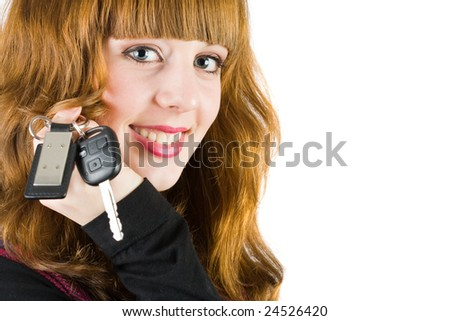 Young attractive sales woman offering car keys
