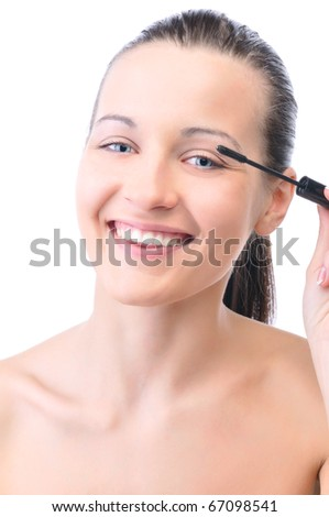 young attractive sensual woman is applying cosmetics on her face and looking at camera, isolated on white