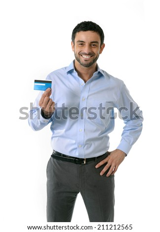 young attractive smart casual man wearing blue shirt showing credit card smiling happy isolated on white background in financial success, online shopping, e-commerce and banking concept - stock photo