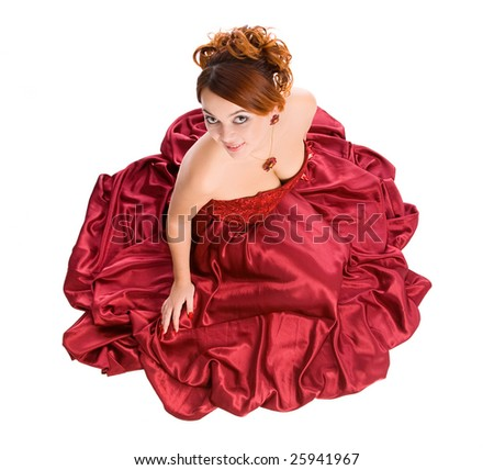 young attractive smiley sitting woman in long red dress - stock photo