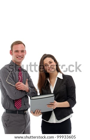 Young attractive smiling businessman and businesswoman standing looking at a folio together during an informal meeting and discussion isolated on white