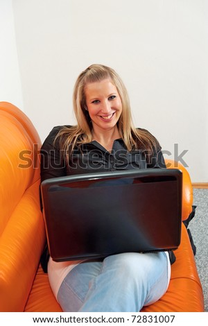 Young attractive smiling woman with laptop