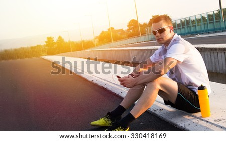 Young attractive sport man.Lens flare - stock photo