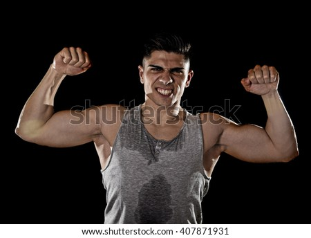 young attractive sport man with big and strong athletic body posing with arms bent showing bicep muscle chest and shoulders in healthy fitness club and corporate gym concept isolated on black - stock photo