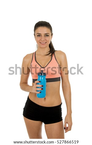 young attractive sport woman in fitness clothes smiling happy posing with water bottle in aerobics training workout isolated on white background in sport healthy lifestyle concept