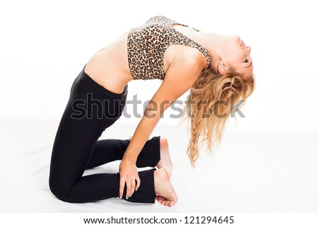 Young attractive sporty fitness woman stretching her body, isolated on white background. - stock photo