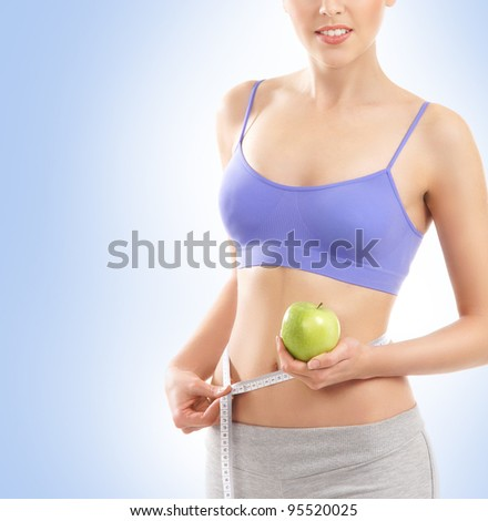 Young attractive sporty woman isolated on blue - stock photo