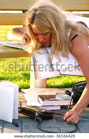 young attractive student reading book