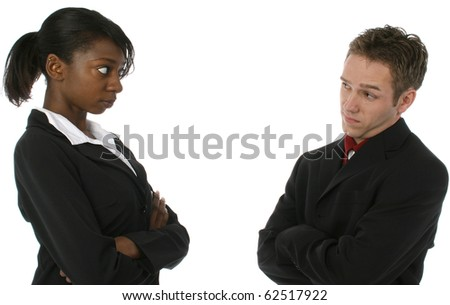 Young attractive team looking at each other with unhappy expressions over white background. - stock photo