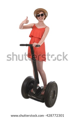 young attractive tourist woman in chic summer dress smiling happy riding electrical segway giving thumb up having fun driving isolated on white background in ecological transport concept - stock photo