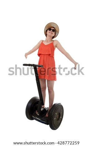 young attractive tourist woman in chic summer dress smiling happy riding electrical segway having fun hands free driving isolated on white background in ecological transport concept - stock photo