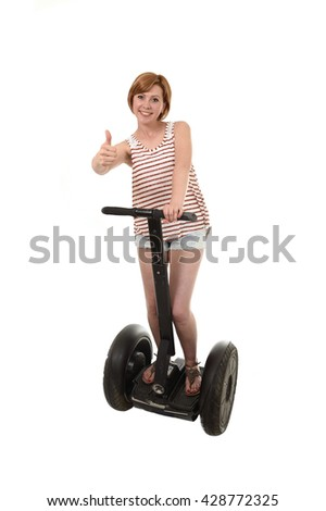 young attractive tourist woman with red hair wearing summer shorts smiling happy riding electrical segway having fun driving isolated on white background in ecological transport concept - stock photo