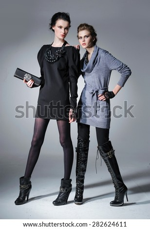 young attractive two girl wearing black and grey cloth posing  - stock photo