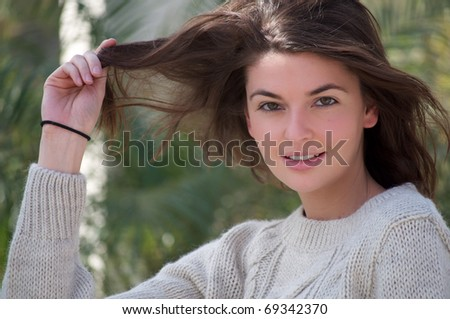 Young Attractive white woman posing with a tropical background - stock photo