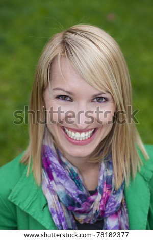 Young attractive woman casually dressed portraited in the park - stock photo