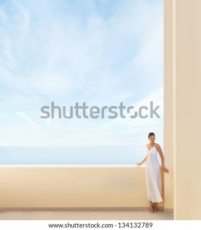 Young attractive woman chilling at the resort. Image has a lot of blank space. - stock photo