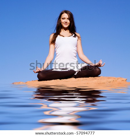 Young attractive woman doing meditation and yoga - stock photo