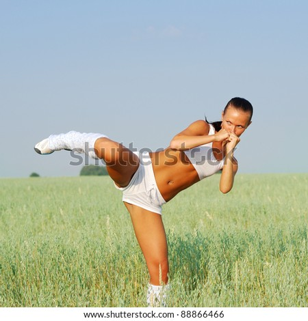 Young attractive woman doing morning sports exercises - stock photo
