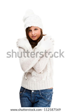 Young attractive woman dressed in winter clothes isolated on white background