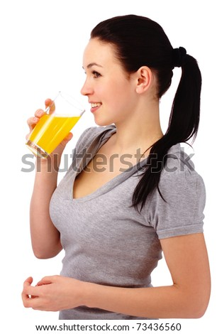 Young attractive woman drinks orange juice, isolated over white - stock photo
