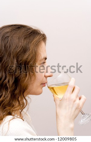 young attractive woman drinks white wine glass cocktail party beauty - stock photo