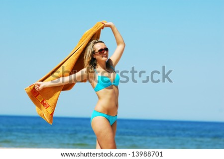 Young attractive woman enjoying summertime on the beach