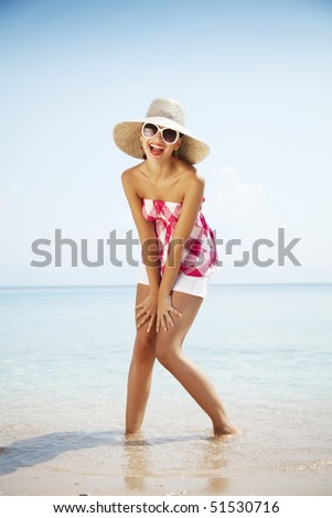 young attractive woman enjoying the beach - stock photo