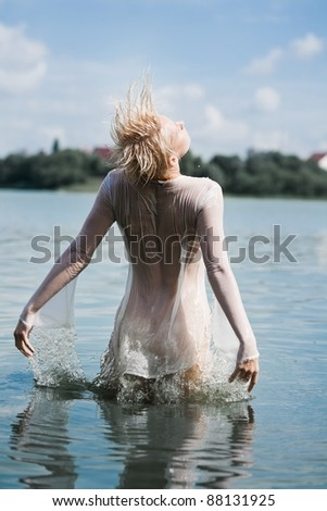 Young attractive woman enjoying water