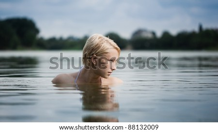 Young attractive woman enjoying water - stock photo