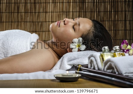 Young attractive woman getting spa and massage - stock photo