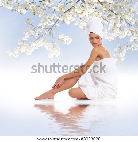 Young attractive woman getting spa treatment isolated on white - stock photo