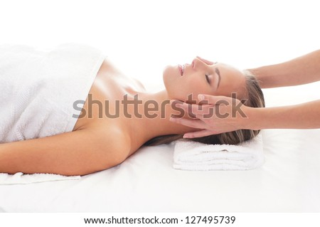 Young attractive woman getting spa treatment over white background - stock photo