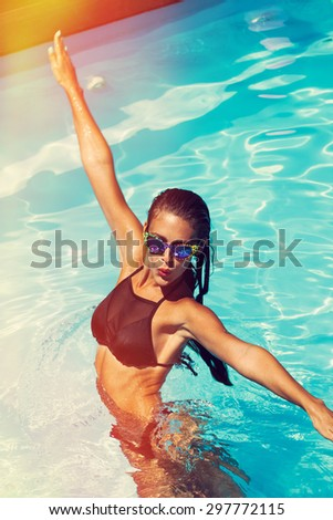 young attractive woman have a fun in pool - stock photo