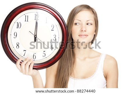 young attractive woman holding big clock