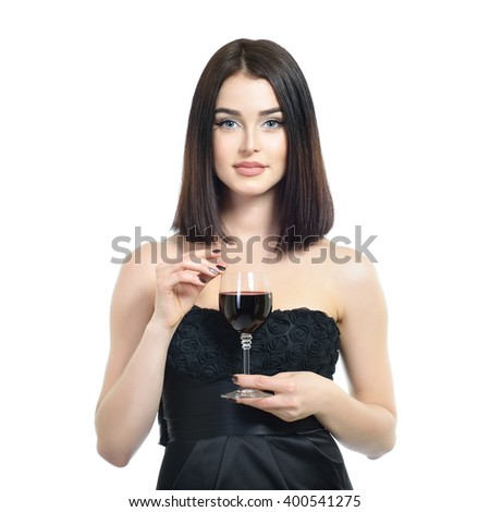 Young attractive woman holding glass with red wine.