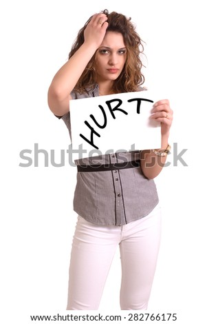 Young attractive woman holding paper with Hurt text on white background