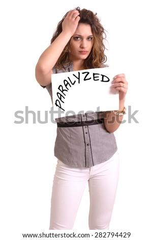 Young attractive woman holding paper with Paralyzed text on white background - stock photo