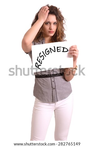 Young attractive woman holding paper with Resigned text on white background