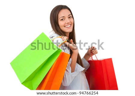 Young attractive woman holding some shopping bags. - stock photo