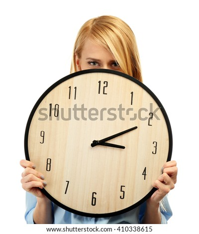 Young attractive woman holds a clock, isolated on white - stock photo