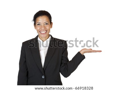 Young attractive woman holds palm for blank ad space . Isolated on white background. - stock photo