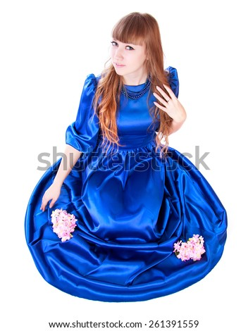 Young attractive woman in a long blue evening dress isolated over white background - stock photo