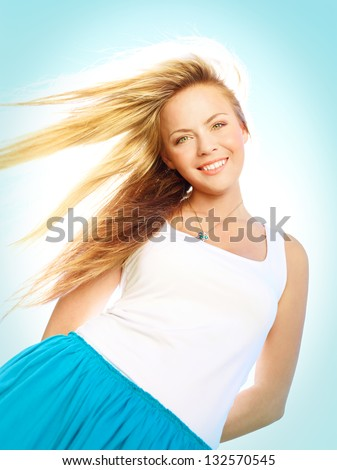 Young attractive woman in a sunlight on a summer day - stock photo