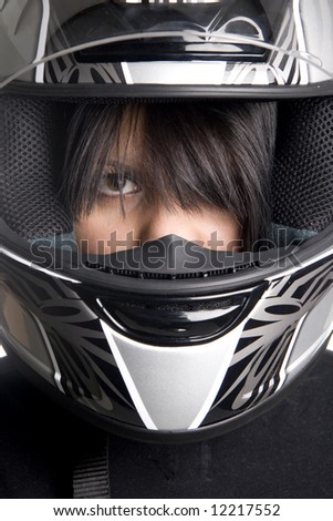 young attractive woman in big motorcycle helmet - stock photo